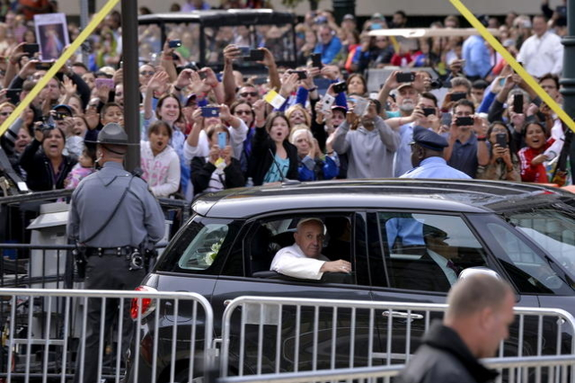 Pope Francis passes fans in his Fiat as he arrives for mass at the Basilica of St. Peter and Paul, in Philadelphia, Pennsylvania, September 26, 2015. (Charles Mostoller/Reuters)
