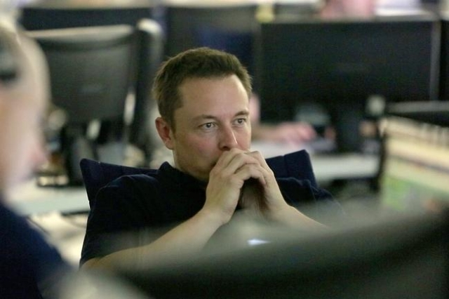 Sitting in the SpaceX Mission Control in Hawthorne, California, SpaceX CEO and Chief Designer Musk Elon watches his space capsule Dragon's progress as it heads for splash down in the Pacific ...