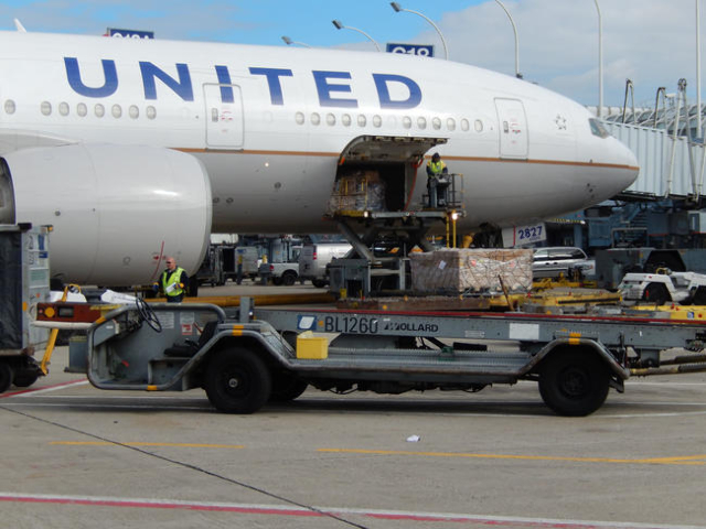 [FILE] Crews service a United Airlines jet as it sits at a gate at O'Hare International Airport in Chicago, Illinois on Oct. 25, 2013.