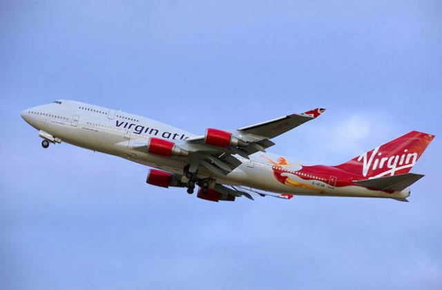 FILE -- A photograph of a Boeing 747 aircraft painted in Virgin Atlantic livery & logo.