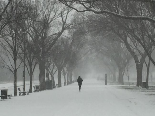 A lone jogger on the National Mall in Washington, D.C. (CNN)