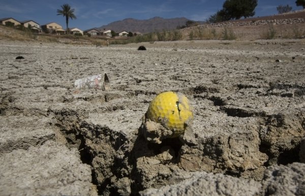 A golf ball sits in a dried water hazard at the closed Silverstone Golf Club Thursday, Sept. 24, 2015. (Jeff Scheid/Las Vegas Review-Journal)