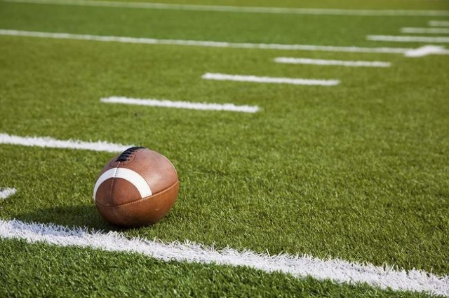 An American football on field (Thinkstock)
