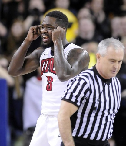 UNLV guard Jordan Cornish (3) encourages his teammates to play smarter after they turned the ball over, Tuesday, Jan. 19, 2016, in Logan, Utah. (Eli Lucero/Herald Journal)