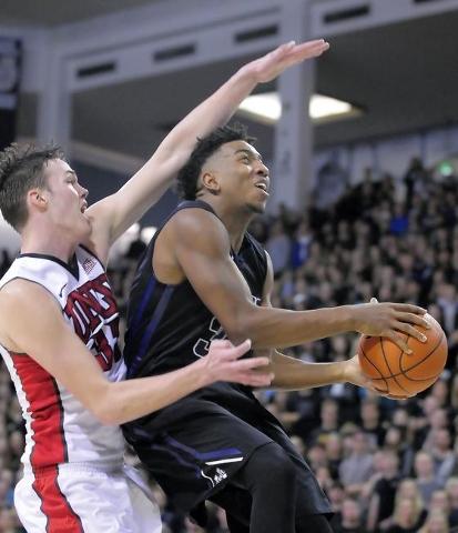 Utah State guard Chris Smith (34) drives to the basket as UNLV forward Stephen Zimmerman Jr. (33) defends, Tuesday, Jan. 19, 2016, in Logan, Utah. (Eli Lucero/Herald Journal)