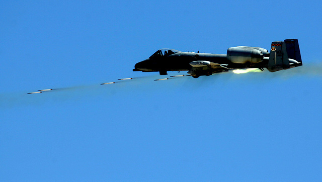 An A-10 Thunderbolt II attack aircraft launches rockets while making an attack run during a Force Firepower demonstration at Point Bravo north of Nellis Air Force Base Friday, Sept. 14, 2007. JOHN ...