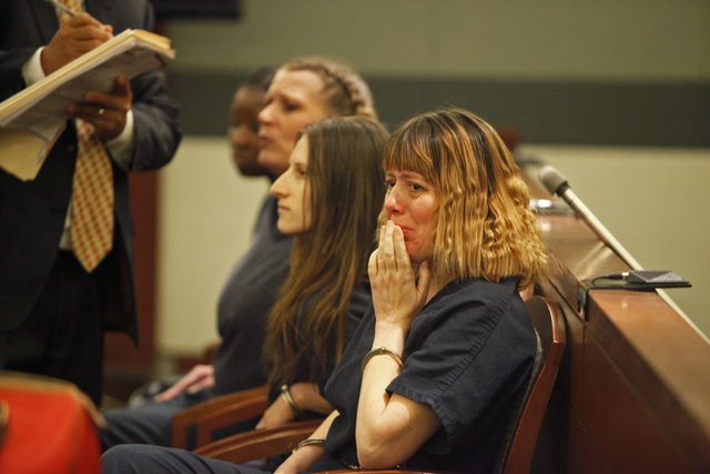 Terrie Sena reacts after receiving a life sentence in Judge Kerry Earley's court on Thursday, June 4, 2015, in Las Vegas. Sena was convicted of videotaping sexual acts with children. (James Tens ...