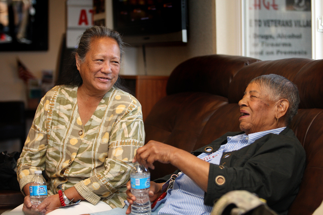 In the offices of Veterans Village, Cynthia Kamale Dias, left, who was a Navy corpsman in Vietnam, shares a laugh with 83-year-old Violet Young, who was in the Women's Army Corps during the  ...