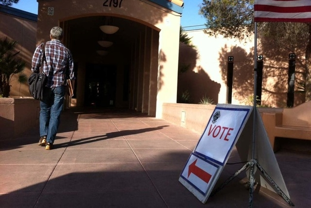 A sign directs voters to the polling place at the Green Valley Library in Henderson on Tuesday, April 7, 2015. (Michael Quine/Las Vegas Review-Journal)
