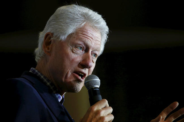Former U.S. President Bill Clinton, accompanied by his daughter Chelsea, speaks at Abraham Lincoln High School while campaigning for his wife, U.S. Democratic presidential candidate Hillary Clinto ...