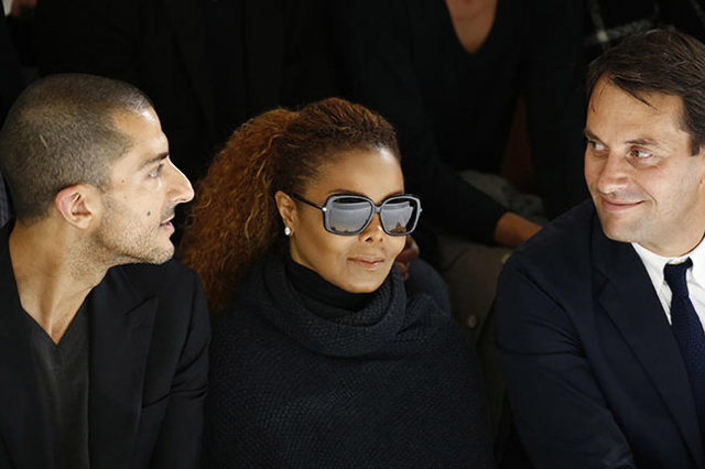 Artist Janet Jackson (C) and her husband  Wissam Al Mana (L) attend the Hermes Spring/Summer 2016 women's ready-to-wear collection show in Paris, France, October 5, 2015. REUTERS/Benoit Tessier