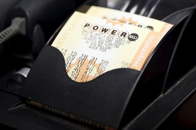 Powerball lottery tickets are seen at Bluebird Liquor in Hawthorne, Los Angeles, California, United States, January 12, 2016.  REUTERS/Lucy Nicholson