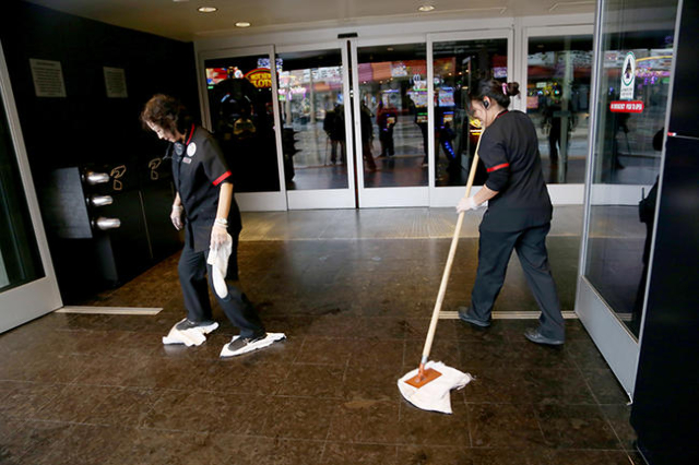 Workers from the D Hotel and Casino clean up rain in the doorway of the casino in downtown Las Vegas Sunday, Jan. 31, 2016. (Rachel Aston/Las Vegas Review-Journal Follow @ rookie__rae)