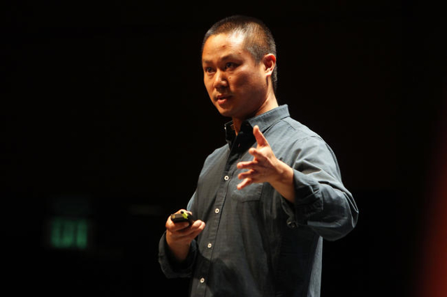 """Zappos CEO Tony Hsieh addresses his employees during their quarterly """"All Hands Meeting"""" Wednesday, Feb. 11, 2015 at the Cashman Center. (Sam Morris/Las Vegas Review-Journal)"""