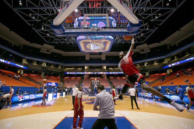 UNLV basketball player Derrick Jones Jr.  throws down a dunk during warm ups before the game against the Boise State Broncos at Taco Bell Arena in Boise, Idaho. Tuesday February 23, 2016. (Kyle Gr ...