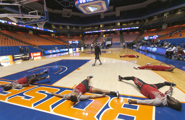 UNLV basketball players stretch during warm ups before the game against the Boise State Broncos at Taco Bell Arena in Boise, Idaho. Tuesday February 23, 2016. (Kyle Green/Las Vegas Review-Journal)
