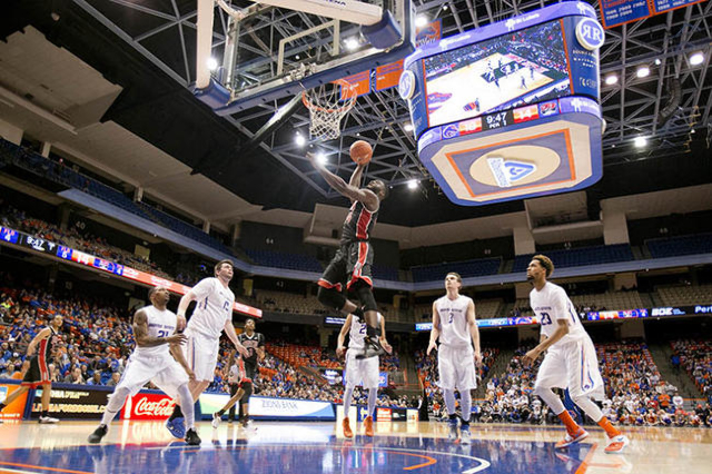 UNLV basketball player Ike Nwamu (34) goes up for a dunk against the Boise State defense during the game at Taco Bell Arena in Boise, Idaho. Nwamu missed the dunk. Boise State led UNLV 35-34 at ha ...