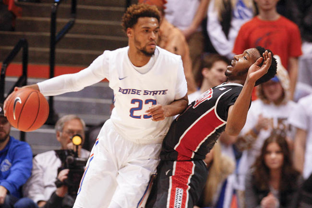 UNLV player Derrick Jones Jr. (1, right) defends against Boise State player James Webb III (23, left) during the game at Taco Bell Arena in Boise, Idaho. Boise State led UNLV 35-34 at halftime. Tu ...