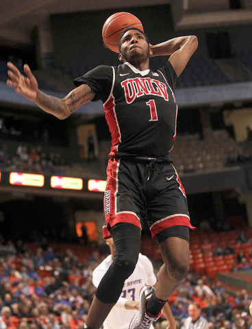 UNLV player Derrick Jones Jr. (1) dunks against the Boise State defense during the game at Taco Bell Arena in Boise, Idaho. Boise State led UNLV 35-34 at halftime. Tuesday February 23, 2016. (Kyle ...