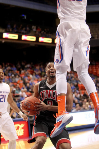 UNLV guard Jerome Seagears (2) gets Boise State defender James Webb III (23) off his feet during the game at Taco Bell Arena in Boise, Idaho. Boise State led UNLV 35-34 at halftime. Tuesday Februa ...