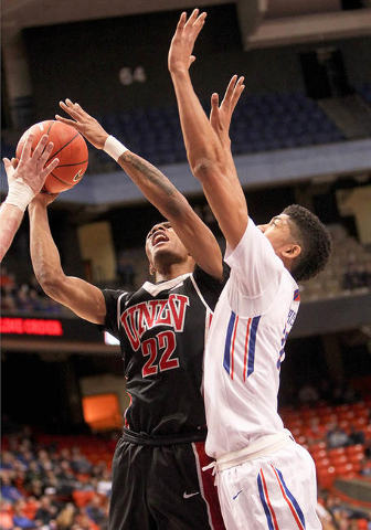 UNLV player Patrick McCaw (22) gets fouled by Boise State player Lonnie Jackson (25) during the game at Taco Bell Arena in Boise, Idaho. Boise State led UNLV 35-34 at halftime. Tuesday February 23 ...