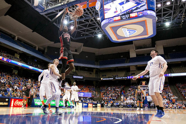 UNLV basketball player UNLV player Derrick Jones Jr. (1) dunks against the Boise State defense at Taco Bell Arena in Boise, Idaho. Boise State led UNLV 35-34 at halftime. Tuesday February 23, 2016 ...