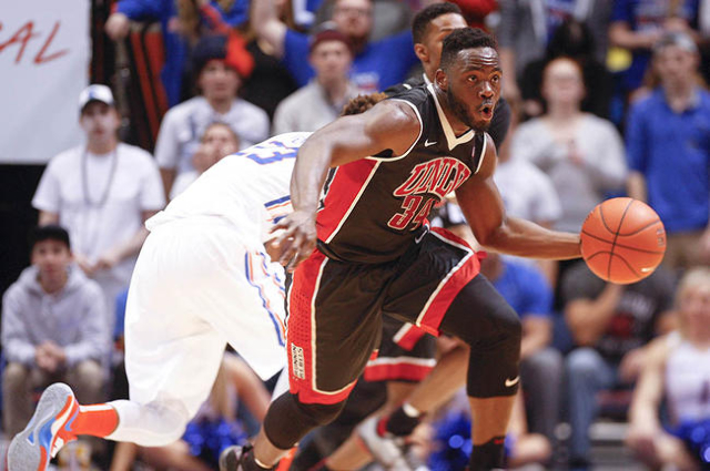 UNLV player Ike Nwamu (34) controls a loose ball from Boise State player James Webb III (23) during the game at Taco Bell Arena in Boise, Idaho. Boise State led UNLV 35-34 at halftime. Tuesday Feb ...