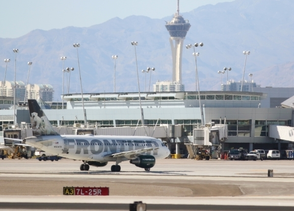 A Frontier Airlines aircraft taxis shortly after landing at McCarran International Airport Friday, July 24, 2015, in Las Vegas. (Ronda Churchill/Las Vegas Review-Journal)