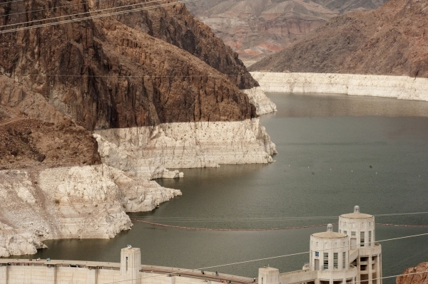 "The ""bathtub ring"" around the mountains of Lake Mead near the Hoover Dam is shown Thursday, April 23, 2015. Projections from the U.S. Bureau of Reclamation indicate Lake Mead could fall  ..."