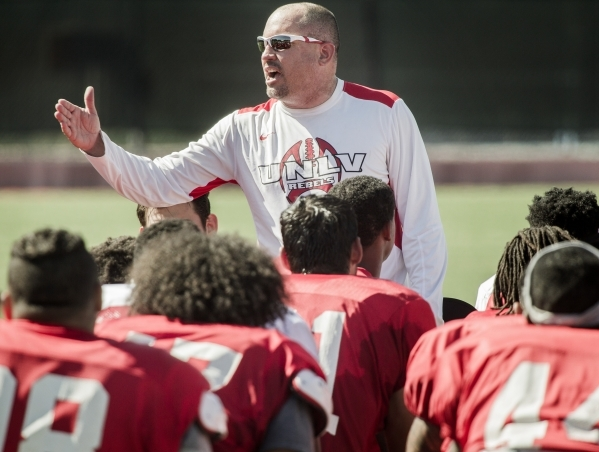 UNLV Men's football coach Tony Sanchez talks to players at the end of practice at Rebel Park on Monday, Aug. 10, 2015.JEFF SCHEID/LAS VEGAS REVIEW-JOURNAL Follow him @jlscheid