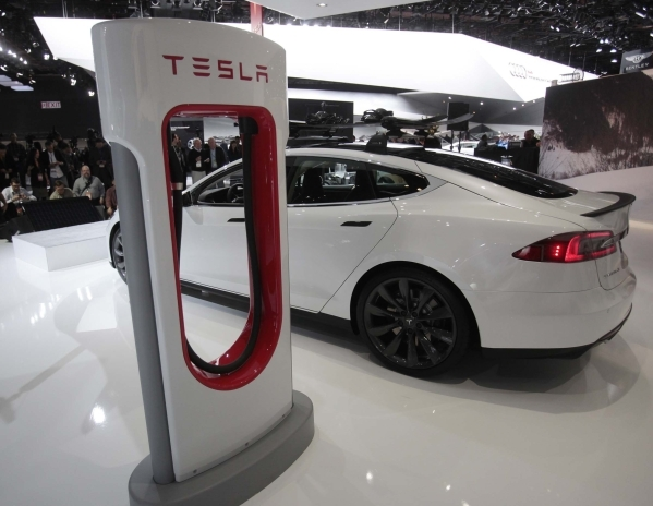 A Tesla S electric car and a charging station are displayed during the press preview day of the North American International Auto Show in Detroit, Jan. 14, 2014.  (Rebecca Cook/Files/Reuters)