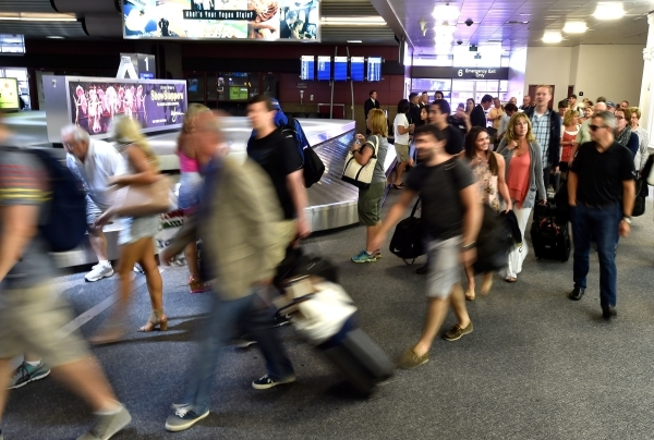 Passengers arrive at the baggage claim area at McCarran International Airport on Friday, Sept. 4, 2015, in Las Vegas. (David Becker/Las Vegas Review-Journal)