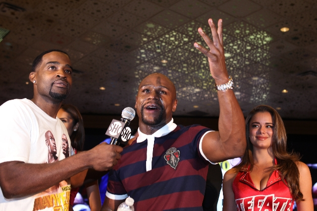 "Floyd Mayweather Jr., center, is interviewed during the ""grand arrival"" event before his fight against Andre Berto at the MGM Grand casino-hotel in Las Vegas Tuesday, Sept. 8, 2015. ERIK ..."