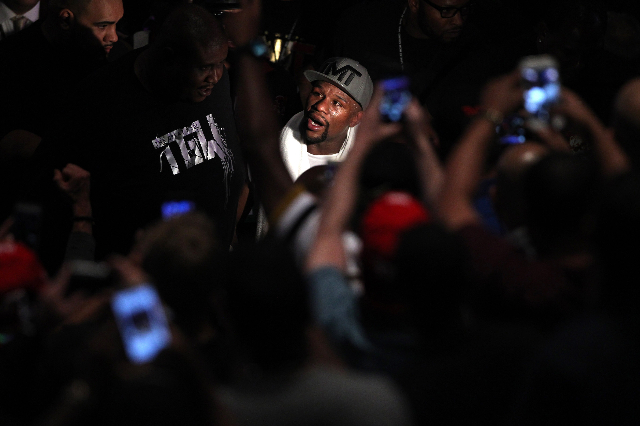 Floyd Mayweather looks up to the crowd as he left MGM Grand Garden Arena after his victory against Andre Berto in their WBC/WBA Welterweight Title bout Saturday, Sept. 12, 2015 in Las Vegas. Maywe ...