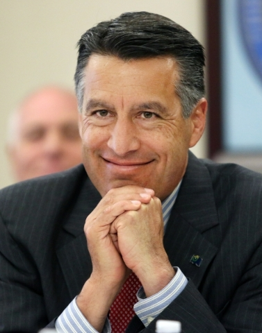 Gov. Brian Sandoval listens to a presentation during a Nevada Governor's Office of Economic Development meeting at Grant Sawyer Building Thursday, Sept. 17, 2015, in Las Vegas. Gov. Sandoval ...