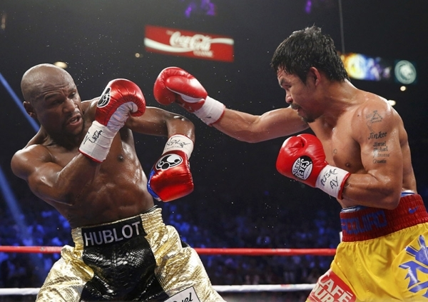 Manny Pacquiao of the Philippines (R) and Floyd Mayweather, Jr. of the U.S. fight in the seventh round during their welterweight WBO, WBC and WBA (Super) title fight in Las Vegas, Nevada, May 2, 2 ...