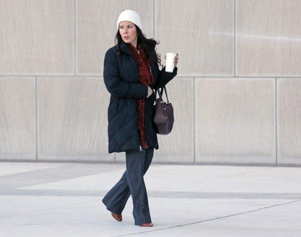 Former Las Vegas real estate broker Eve Mazzarella enters Lloyd George U.S. Courthouse Wednesday, Dec. 16, 2015, in Las Vegas. Mazzarella appeared before U.S. District Judge James Mahan regarding  ...