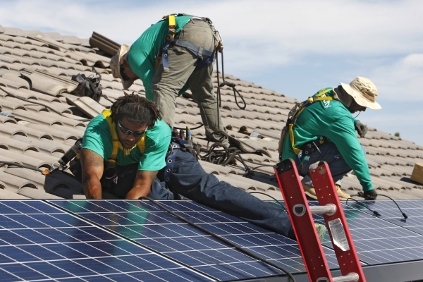 From left, Solar City installation crew leader Greg Kates, Guillermo Aviles and Lyle Bradford install solar panels on a North Las Vegas home Thursday, Oct. 30, 2014. (Sam Morris/Las Vegas Review-J ...