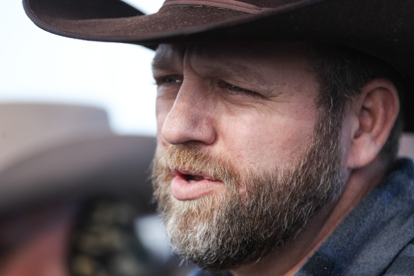 Ammon Bundy, right, speaks during a news conference by the entrance of Malheur National Wildlife Refuge headquarters near Burns, Ore. on Wednesday, Jan. 6, 2016. Chase Stevens/Las Vegas Review-Jou ...
