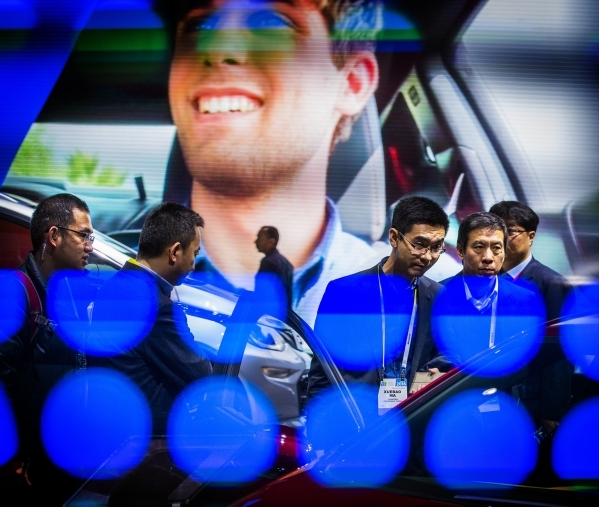 Men look at the 2016 all electric Volt at the Chevrolet booth during CES in the Las Vegas Convention Center on Friday, Jan. 8,2016. Jeff Scheid/Las Vegas Review-Journal Follow him @jlscheid °   ...