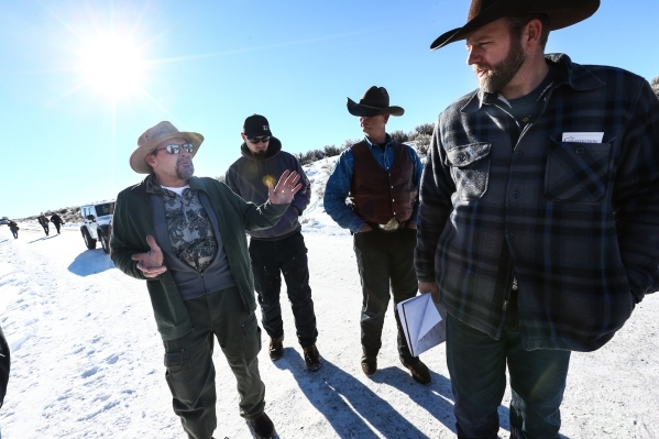 Steve Atkins, left, of Burns, Ore. voices his discontent over the occupation with Ammon Bundy, right, at Malheur National Wildlife Refuge headquarters near Burns, Ore. on Friday, Jan. 8, 2016. Bun ...