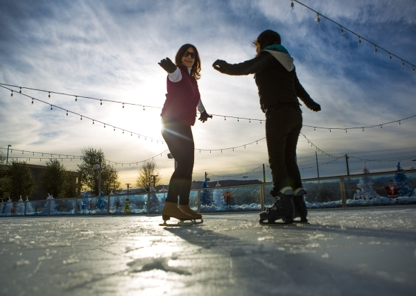 Volunteer Denise McDonald, left, gives 21-year-old Gladys Perez, who is visually impaired, a skating lesson at Downtown Summerlin´s Rock Rink on Wednesday, Jan. 13, 2016. Volunteers gave about  ...