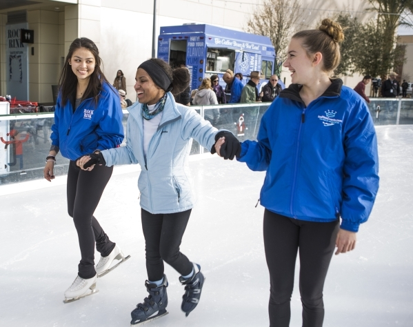 Volunteers Marisa Becker, left, and Elise Griffin, right, hold hands with visually impaired Niki White, 24, while skating at Downtown Summerlin´s Rock Rink on Wednesday, Jan. 13, 2016. Voluntee ...