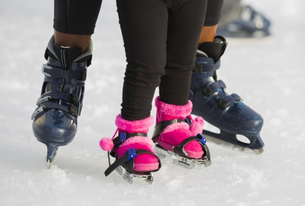 Heaven Wright and her visually impaired daughter Monroe, 2,  experience ice skating together at  Downtown Summerlin´s Rock Rink on Wednesday, Jan. 13, 2016. Volunteers gave around 15 blind and  ...