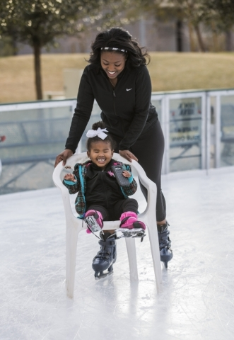Heaven Wright pushes her visually impaired daughter Monroe, 2, in a chair at the Downtown Summerlin´s Rock Rink on Wednesday, Jan. 13, 2016. Volunteers gave around 15 blind and visually impaire ...