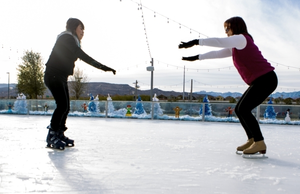 Volunteer Denise McDonald, right, gives visually impaired  Gladys Perez, 21, a skating lesson at Downtown Summerlin´s Rock Rink on Wednesday, Jan. 13, 2016. Volunteers gave around 15 blind and  ...