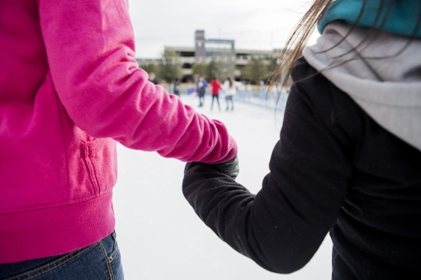 Volunteer Ja'Nesha Murphy, 21, left, and visually impaired skater Gladys Perez, 21, hold hands while skating at  Downtown Summerlin´s Rock Rink on Wednesday, Jan. 13, 2016. Volunteers gav ...