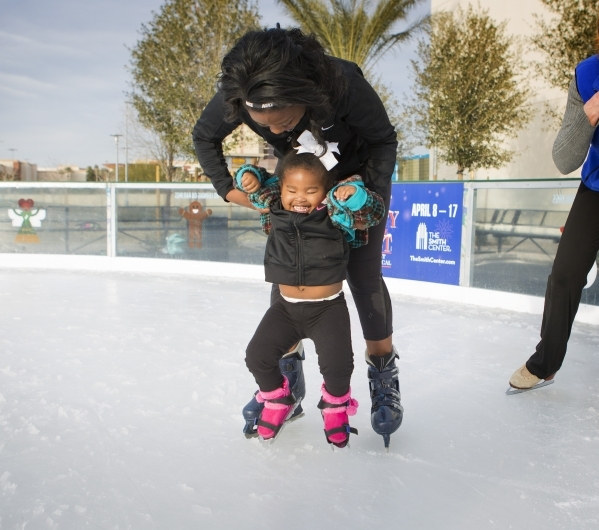 Heaven Wright holds her visually impaired daughter Monroe, 2, while letting her experience ice skating at  Downtown Summerlin´s Rock Rink on Wednesday, Jan. 13, 2016. Volunteers gave around 15  ...