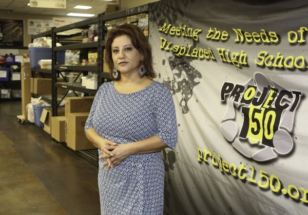 Project 150 Executive Director Meli Pulido poses for a photo at Brady Caipa Volunteer Center's warehouse on Thursday, Jan. 21, 2016, in Las Vegas. Project 150, the local charity that provide ...