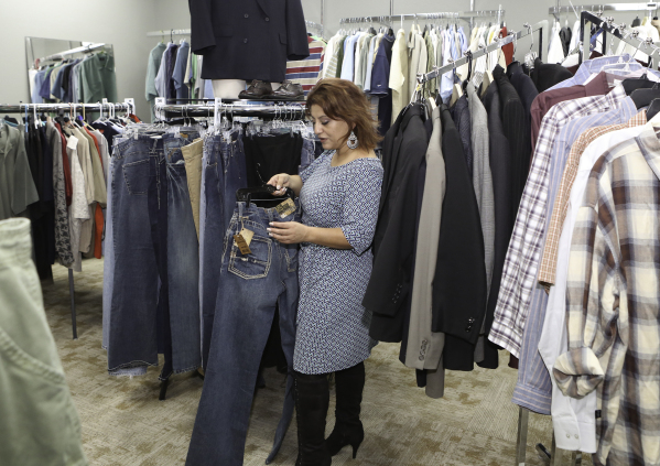 Project 150 Executive Director Meli Pulido holds a pair of donated jeans to Project 150 as she poses for a photo at Betty's boutique on Thursday, Jan. 21, 2016, in Las Vegas. Project 150, th ...
